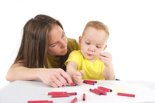 59335056 - mother and son are drawing the picture together. studio shot